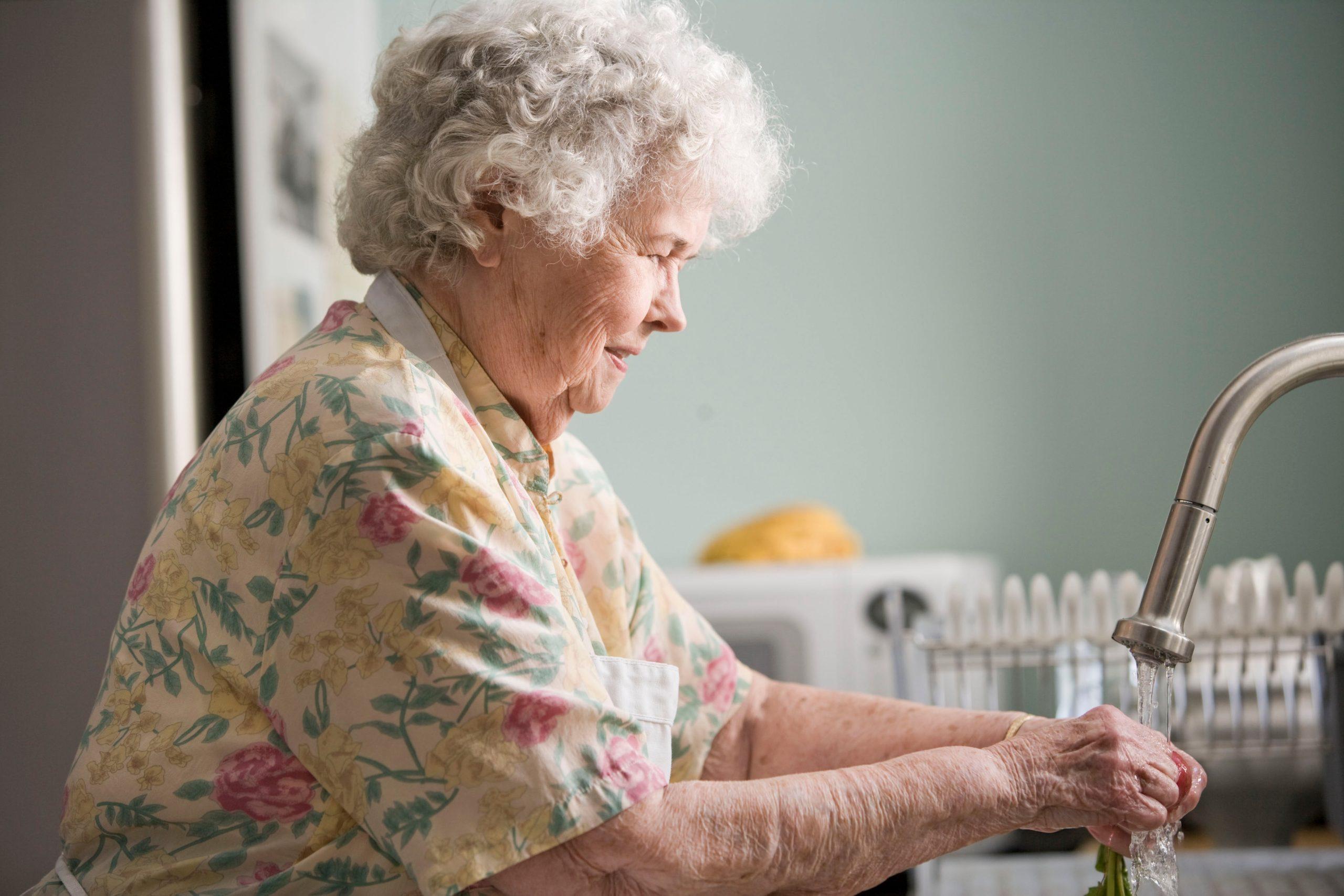 Older woman washing produce